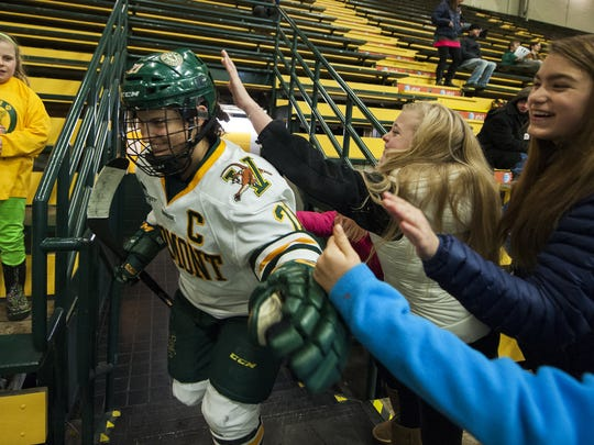 Catamounts forward Amanda Pelkey (21) is greeted by