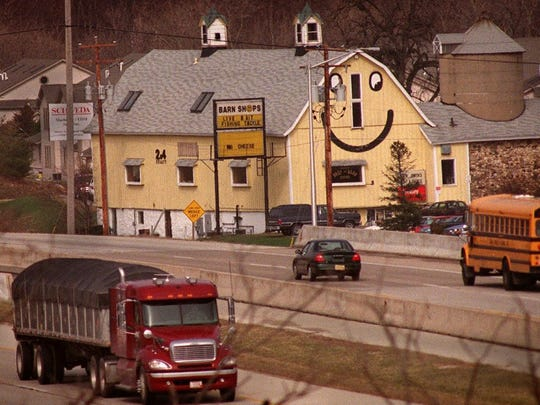 The yellow barn that included a smiley face on I-94 and Highway 83 in Delafield was a well-known landmark for many years. The smiley face, however, was removed in 2001 by the then-owner to a more traditional color scheme to reflect the Amish-made furniture that was sold there. The barn's new owner now wants to restore the smiley face.