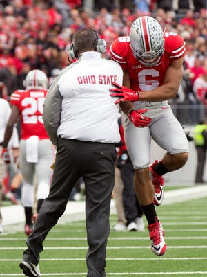 Ohio State coach Urban Meyer and wide receiver Evan Spencer celebrate after a touchdown in Saturday's 42-28 win over Michigan.