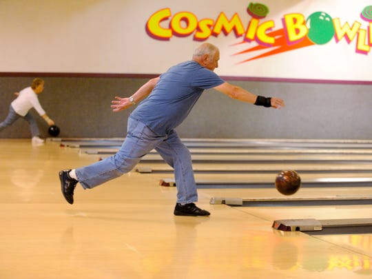 """The Manitowoc County National Guard Association is holding its last reunion in November. Joseph Wilson, an 18-year veteran in the National Guard, enjoys some leisure time bowling with other veterans during senior mixed league at Meadow Lanes West in Manitowoc. His bowling ball is nicknamed the """"arsenal."""""""