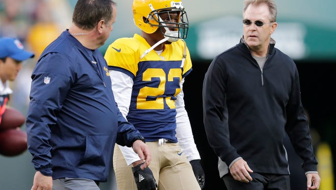 Green Bay Packers cornerback Damarious Randall leaves the field after getting injured against the Dallas Cowboys at Lambeau Field.
