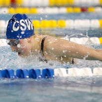 Brooke Travis of the Delaware Military Academy maintains her lead to win the 500-yard freestyle in the DIAA Girls Swimming and Diving State Championship on Saturday at the University of Delaware's Rawstrom Natatorium.