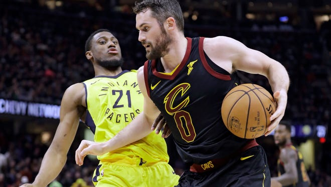 Cleveland's Kevin Love looks for room to maneuver against Indiana?s Thaddeus Young on Sunday in Cleveland. Young was instrumental in holding Love to just nine points in 34 minutes.