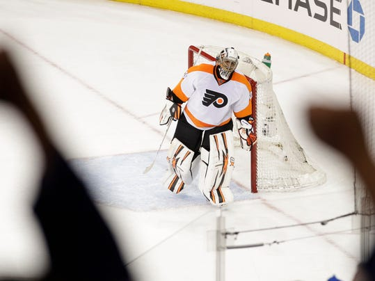 Philadelphia Flyers goalie Ray Emery leaves the ice after Game 1 of an NHL hockey first-round playoff series against the New York Rangers, Thursday, April 17, 2014, in New York. The Rangers won the game 4-1. (AP Photo/Frank Franklin II)
