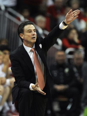 UofL head coach Rick Pitino is upset with a call as his Cardinals take on Kentucky on Saturday at the KFC YUM! Center. (By David Lee Hartlage, Special to the C-J) Dec. 27, 2014.