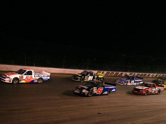 Jul 24, 2013; Rossburg, OH, USA; NASCAR Camping World Truck Series driver Ken Schrader leads the field to start the Mudsummer Classic at Eldora Speedway.