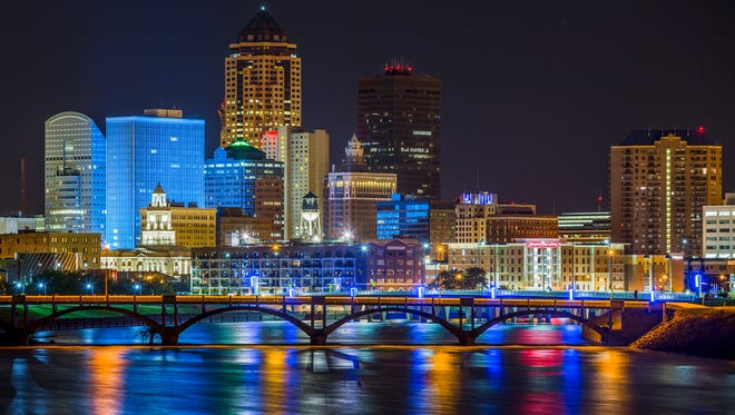 The Des Moines skyline shines over the confluence of the Des Moines and Raccoon Rivers Tuesday, Aug. 25, 2015.