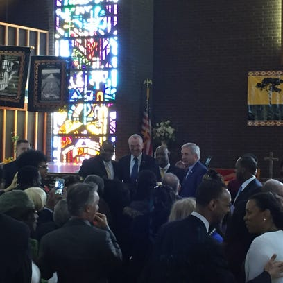 NJ Gov. Phil Murphy poses for photos after speaking