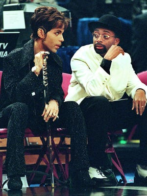 Filmmaker Spike Lee (R), a New York Knicks season ticket-holder, talks with the musician formerly known as Prince (L) during the NBA All-Star Game at Madison Square Garden 08 February. The Eastern Conference All-Stars beat the Western Conference 135-114.
