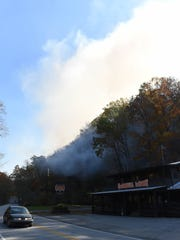 A fire burns along Quarry Creek off State Highway 165,