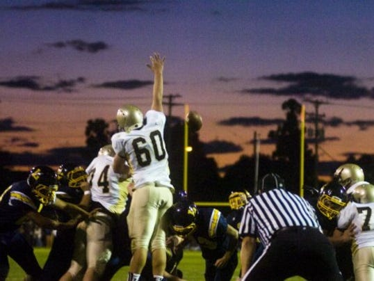 Delone Catholic's Connor Bossom jumps in an attempt to stop an extra-point kick during Friday's game against Littlestown. The Thunderbolts beat the Squires, 47-7. (GameTimePA.com -- Shane Dunlap)