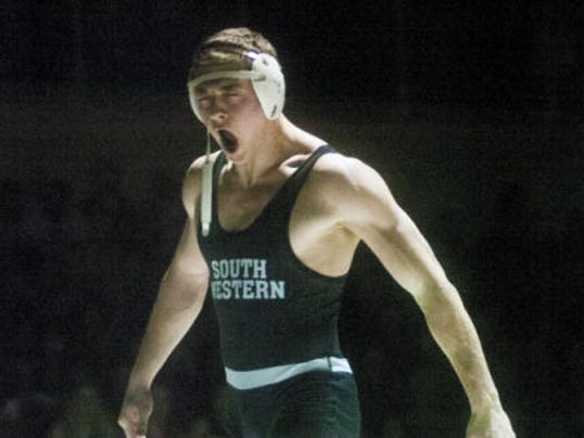 South Western's Logan Bowman howls in celebration after winning the 195-pound bout during Thursday's match against Spring Grove. Bowman pinned the Rockets' Joshua Cribbs in 54 seconds, and the Mustangs earned a 34-27 victory. South Western's win creates a three-way tie atop the YAIAA Division I standings with Spring Grove and New Oxford. Each sits at 8-1 with one match left this season. (Shane Dunlap -- GameTimePA.com)
