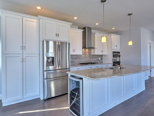 The kitchen features a granite stone center island.