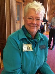 Sen. Diane Sands, D-Missoula, trimmed a dollar bill