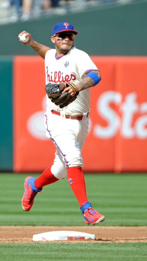 Philadelphia Phillies third baseman Freddy Galvis (13) throws to first base during the fourth inning Sept. 28 against the Atlanta Braves at Citizens Bank Park. Credit: Eric Hartline-USA TODAY Sports
