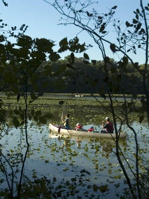 Canoe on the Rancocas Creek during Sunday's Fall Foliage Family Float Festival at Historic Smithville Park, Eastampton NJ.(SCOTT ANDERSON / Courier-Post)