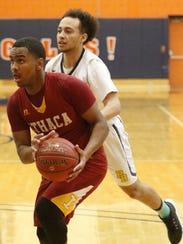 Jamar Nembhard of Ithaca drives toward the basket as