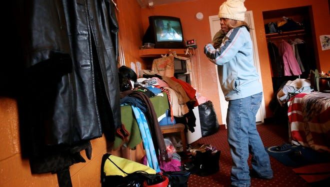 Tara Clinton, 47, of Ferndale, gets ready for work inside her room at Motorama Motel on Friday, Feb. 12, 2016, in Ferndale.