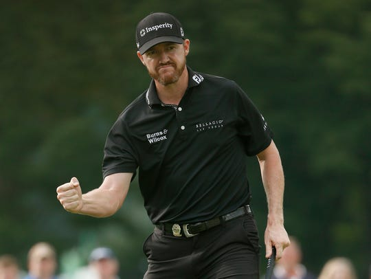 Jimmy Walker reacts to his birdie putt on the 11th