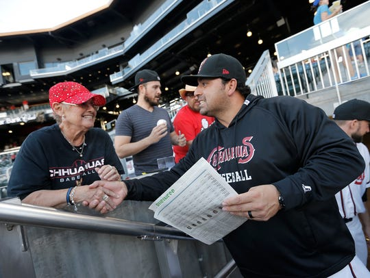 El Paso Chihuahuas' field manager Rod Barajas is congratulated