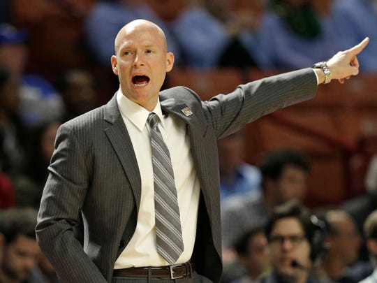 Seton Hall head coach Kevin Willard directs his team against Arkansas during the first half in a first-round game of the NCAA men's college basketball tournament in Greenville, S.C., Friday, March 17, 2017. (AP Photo/Chuck Burton)