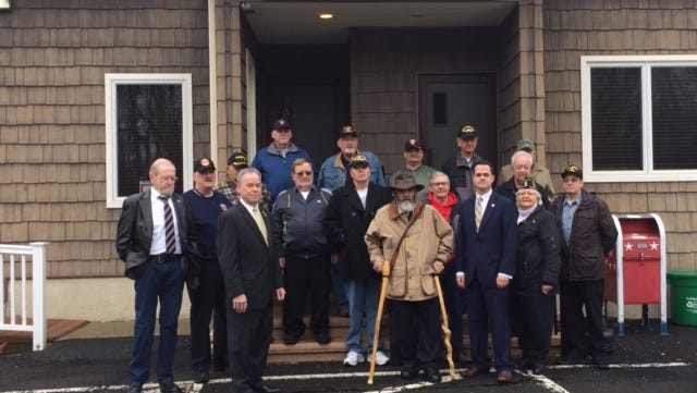 A group of veterans and elected officials rally on Jan. 12 in front of Kearsing Edwards American Legion Post in Pomona before heading to a VA town hall meeting at Castle Point.