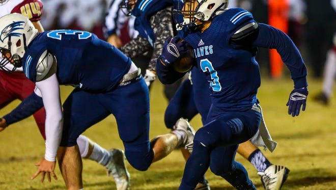 Hardin Valley's Aaron Dykes rushes during a 6A playoff game against Riverdale on Friday at Hardin Valley Academy.