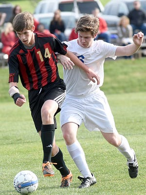 Rossview High freshman Lucas Lightner maintains possession amidst pressure from White House junior Josh Dunlap during first-half action against White House Friday night.