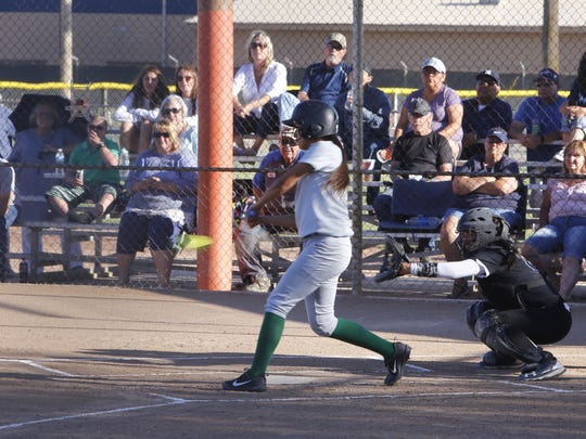 Farmington's Chantorie Sanford hits a leadoff double in the bottom of the first inning against Piedra Vista on Tuesday at the Ricketts Park softball fields in Farmington.