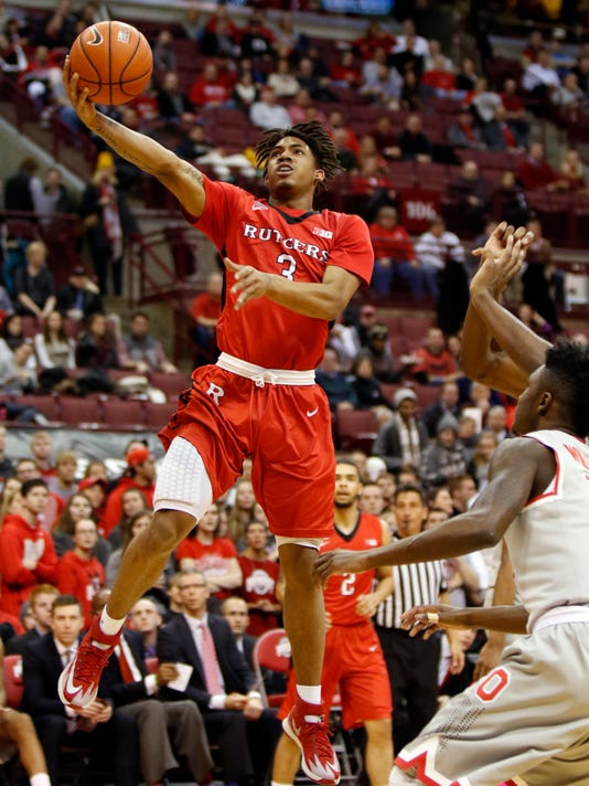 Rutgers' Corey Sanders, left, goes up for a shot over Ohio State's Kam Williams during the first half of an NCAA college basketball game in Columbus, Ohio, Wednesday, Jan. 13, 2016. (AP Photo/Paul Vernon)