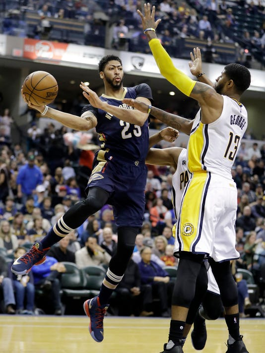 90c36b0a44f New Orleans Pelicans  Anthony Davis makes a pass against Indiana Pacers  Paul  George during