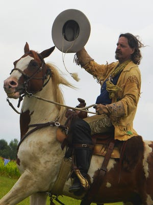 Reenactor Wayne Rettig as Buffalo Bill greets the audience Saturday at Pinecrest Historical Village in Manitowoc during the Best of Buffalo Bill's Wild West show.
