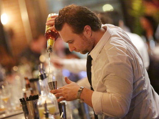 A bartender makes cocktails at Wright & Company restaurant in Detroit, one of the top ten new restaurants according to Detroit Free Press restaurant critic Sylvia Rector.