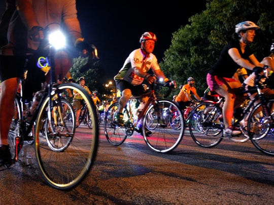 Bicyclists ride down New York Street during the 21st annual Navigate Indy This Evening, or N.I.T.E. Ride, in Indianapolis last year. This year's ride is June 27.