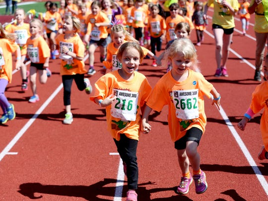 Girls run during the 33rd annual Awesome 3000 for the Salem-Keizer Education Foundation at McCulloch Stadium at Bush's Pasture Park in Salem on Saturday, May 2, 2015.