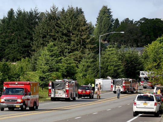 An ambulance leaves the scene after a two-vehicle crash west of Battle Creek Rd., on Kuebler Blvd., in Salem on Monday, May 4, 2015.