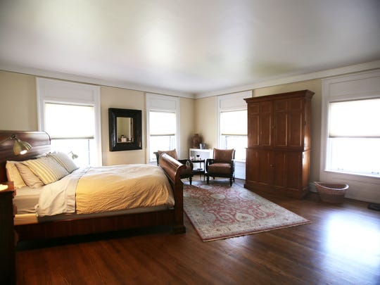 This is the master bedroom of 1480 Seminole in Detroit's Indian Village. It is an Arts & Crafts with Tudor influences that was built in 1910 for Fritz Goebel, son of beer brewer Augustus Goebel. It is detailed with Pewabic tiles, oak beams and Wainscoting, leaded glass and hardwood floors, all restored by the present owners. The home has 5 bedrooms, 4.1 baths, and is 6,200 square feet. It is listed at $614,500 and has a carriage house that is rentable with a wrought iron fence around the home and landscaped. Photographed Tuesday, April 28, 2015.