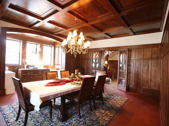 This is the dining room with paneling and a heavy coffered ceiling at 1480 Seminole in Detroit's Indian Village. It is an Arts & Craft with Tudor influences that was built in 1910 for Fritz Goebel, son of beer brewer Augustus Goebel. It is detailed with Pewabic tiles, oak beams and Wainscoting, leaded glass and hardwood floors, all restored by the present owners. The home has 5 bedrooms, 4.1 baths, and is 6,200 square feet. It is listed at $614,500 and has a carriage house that is rentable with a wrought iron fence around the home and landscaped. Photographed Tuesday, April 28, 2015.