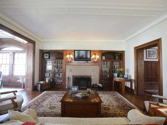 This is the living room with glass-front bookcases at 1480 Seminole in Detroit's Indian Village. It is an Arts & Craft with Tudor influences that was built in 1910 for Fritz Goebel, son of beer brewer Augustus Goebel. It is detailed with Pewabic tiles, oak beams and Wainscoting, leaded glass and hardwood floors, all restored by the present owners. The home has 5 bedrooms, 4.1 baths, and is 6,200 square feet. It is listed at $614,500 and has a carriage house that is rentable with a wrought iron fence around the home and landscaped. Photographed Tuesday, April 28, 2015.
