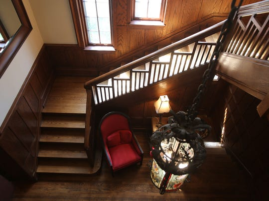 This is the front hallway from the grand stairwell of 1480 Seminole in Detroit's Indian Village. It is an Arts & Craft with Tudor influences that was built in 1910 for Fritz Goebel, son of beer brewer Augustus Goebel. It is detailed with Pewabic tiles, oak beams and Wainscoting, leaded glass and hardwood floors, all restored by the present owners. The home has 5 bedrooms, 4.1 baths, and is 6,200 square feet. It is listed at $614,500 and has a carriage house that is rentable with a wrought iron fence around the home and landscaped. Photographed Tuesday, April 28, 2015.