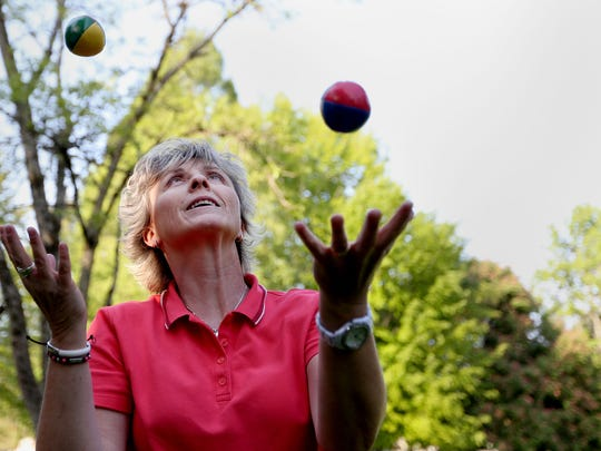 Statesman Journal Columnist Capi Lynn learns to juggle from Corey Jenkins (not pictured) at Willson Park in Salem on Thursday.