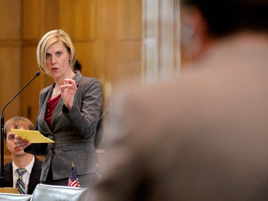 Rep. Jennifer Williamson takes a question from Rep. Cedric Hayden during a debate on the floor of the House of Representatives on Senate Bill 941, the gun background check bill, at the Oregon State Capitol in Salem on Monday.