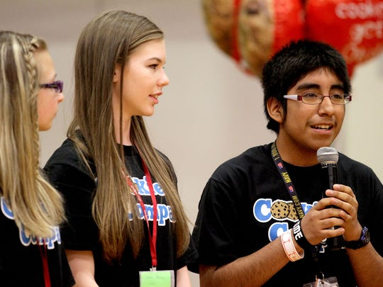 Cookie Company co-CEO Kelby Self (from left), co-CEO Sara Perlin, and production manager Yeudial Alvarez-Flores, all eighth-graders, speak during a cookie contest at Leslie Middle School in Salem on Wednesday, May 6, 2015. Otis Spunkmeyer representatives judged the cookies created and baked by the middle school students. The winning recipe will be made into regulation company cookie dough and sent to the school for baking.