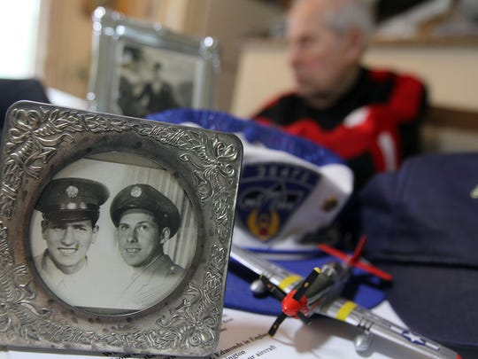 A photo of World War II veteran David Scheinhartz (right, background) and his brother Jacob in Scheinhartz's Middletown home.