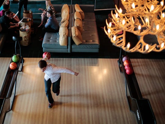 Chris Crane of Rochester makes his approach on the lanes at Punch Bowl Social, which also has ping-pong tables, arcade games and shuffleboard.