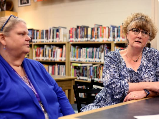 Leslie Van Meter, left, a social studies teacher, and Jessica Dayson, a language arts teacher, speak at the Teen Parent Program, part of the Early College High School, at Chemeketa Community College in Salem, on Thursday, May 7.