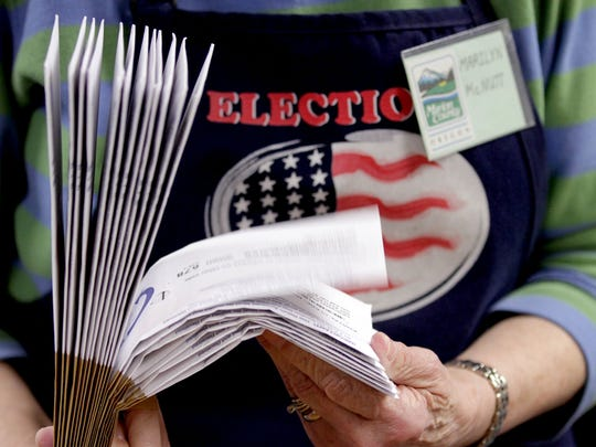 Marilyn McNutt, of Salem, verifies ballot precincts at the Marion County Election Office in Salem on Tuesday, May 12, 2015.