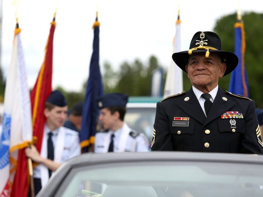 Jesus Monty Montes, who served in Vietnam and was in the U.S. Army for 27 years, rode in the American Legion car during the Iris Festival Parade on Saturday, May 16, 2015, in Keizer, Ore.