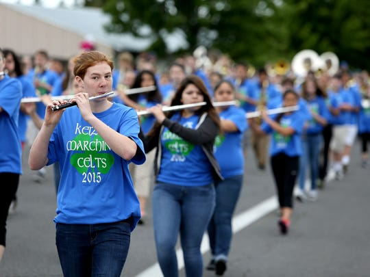 Members of the McNary High School marching band participate Saturday in the Iris Festival Parade in Keizer.