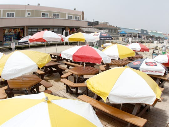 Enjoy a sausage and pepper sandwich or a slice of pizza on the beach at Little Mac's in Point Pleasant Beach.